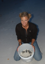 Michelle Jewell with sea turtle hatchlings